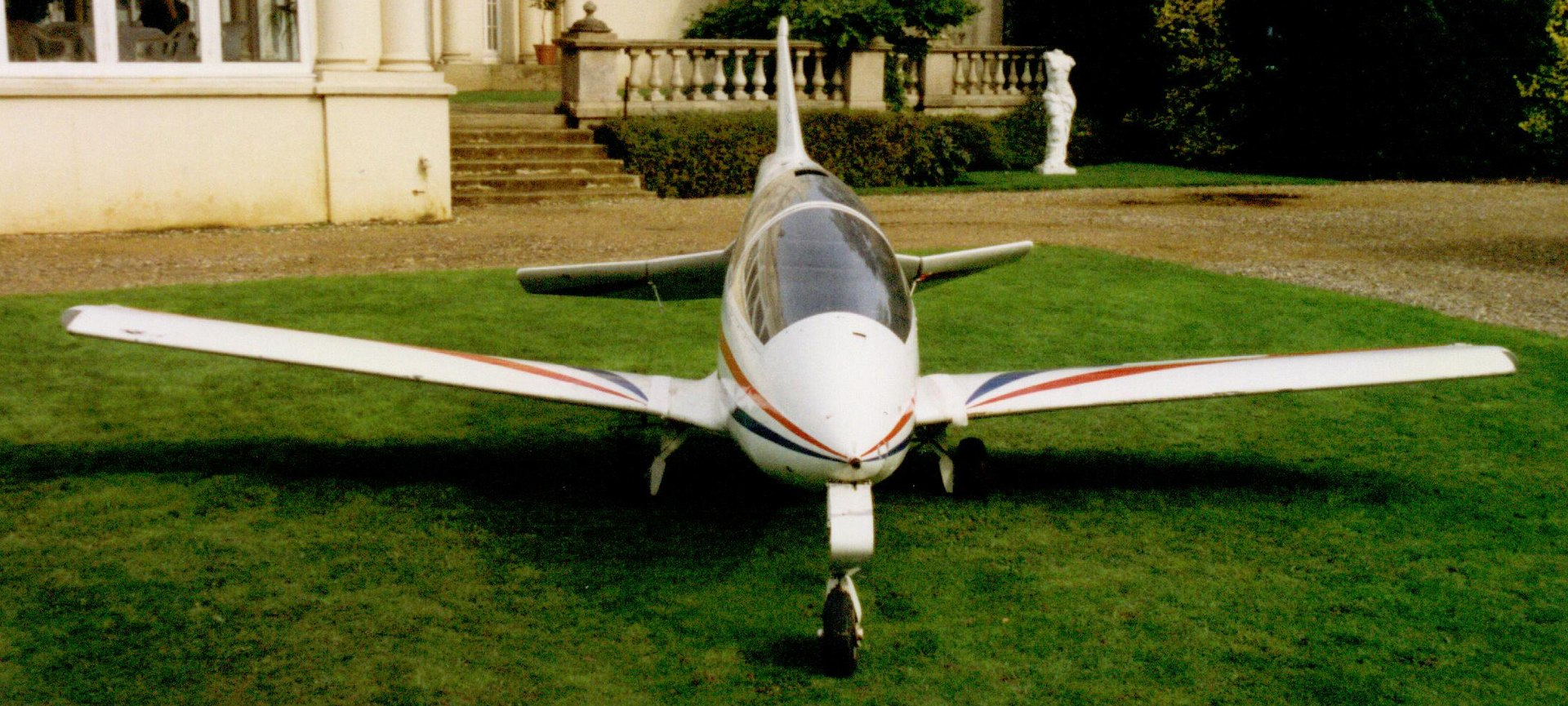 Acrostar, a small white plane with wings that fold up.