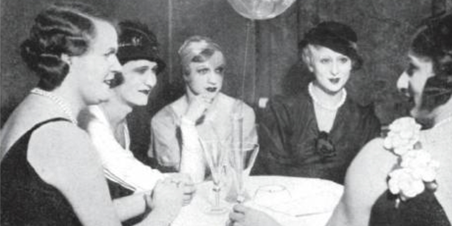 Close-up of middle-aged guests sitting and chatting over a drink in 'Mikado Bar' in the 1920s.