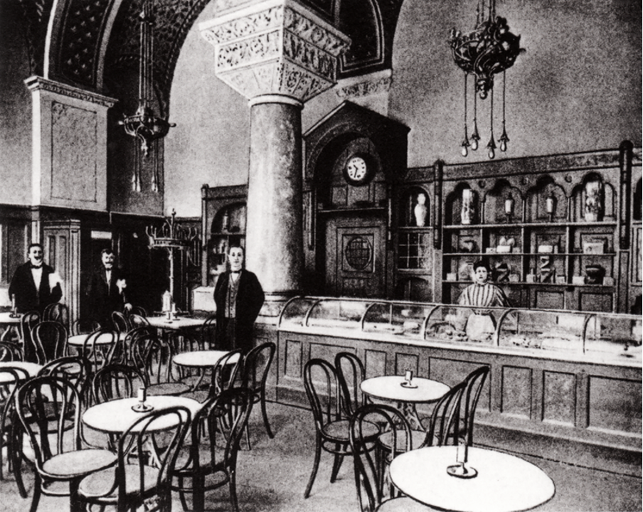 View of the café-bar and some vacant tables from inside of 'Romanisches Café'.