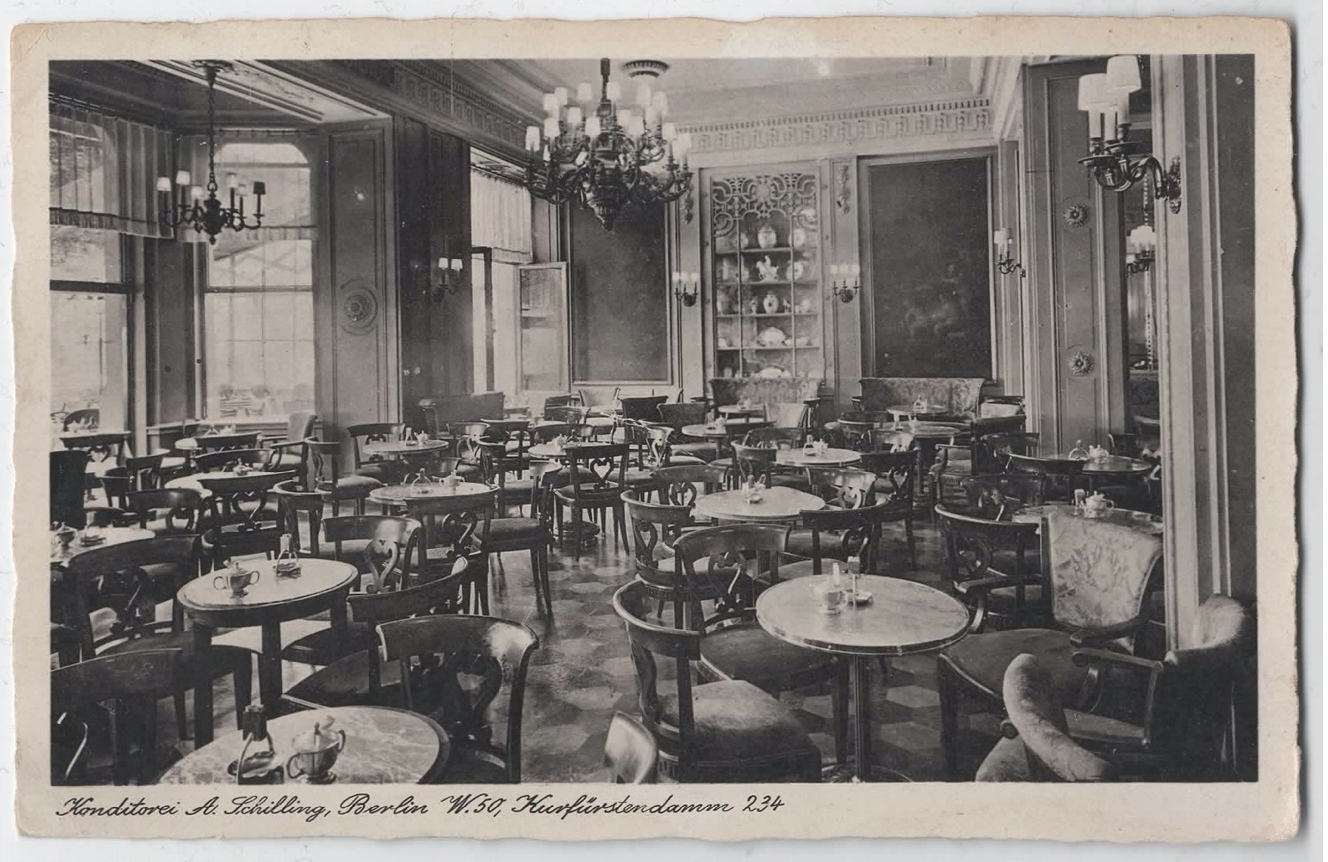 View of some vacant tables from inside of ' Schilling'.